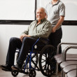 Stock Photo: MWith Grandfather Sitting In Wheelchair