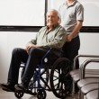 Man With Grandfather Sitting In Wheelchair - Stock Photo