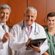 Happy Doctor With Colleagues — Stock Photo