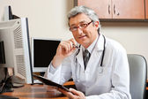 Doctor Sitting At Desk In Front Of Computer — Stock Photo