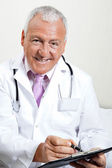 Doctor Writing On Clipboard — Stock Photo