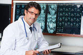 Radiologist At Desk With Clipboard — Stock Photo