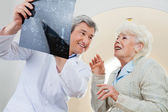 Doctor With Patient Looking At X-ray — Stock Photo