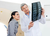 Radiologist And Patient Looking At X-ray — Stock Photo