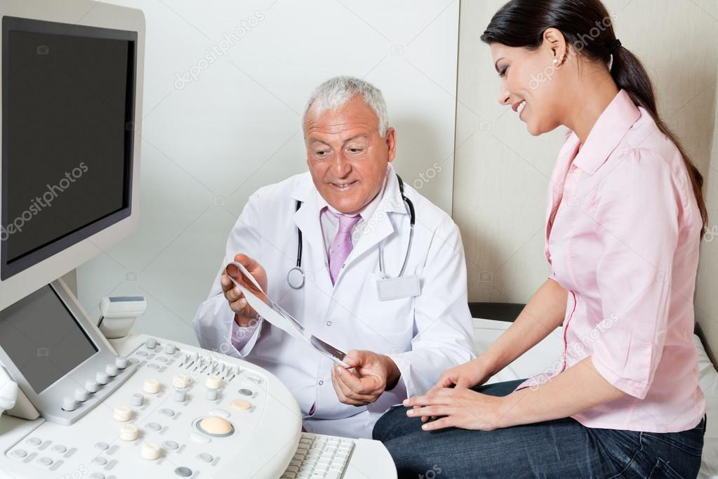 Radiologist Showing Ultrasound Print To Patient � Stock Photo ...