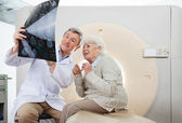 Doctor And Patient Looking At CT Scan X-ray — Stock Photo