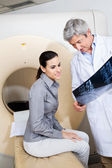 Radiologist Showing X-ray To Female Patient — Stock Photo