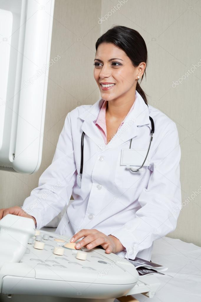 Radiologist Operating Ultrasound Machine � Stock Photo ...