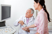 Radiologist Scanning Female Patient's Hand — Stock Photo