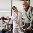 Nurse Helping Senior Patient With Walker — Stock Photo