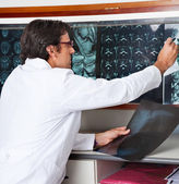 Radiologist Reviewing X-ray At Clinic — Stock Photo