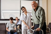 Nurse Helping Senior Patient With Walker — Stockfoto