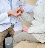 Doctor Comforting Female Patient — Stock Photo