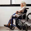 Stock Photo: Pensive Elderly WomOn Wheelchair