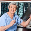 Stock Photo: Happy Radiologist Holding X-ray