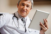 Male Doctor Holding Digital Tablet — Stock Photo