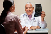Radiologist Showing X-ray To Patient — Stock Photo