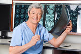 Happy Radiologist Holding X-ray — Stock Photo