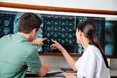 Medical Technicians Pointing At MRI X-ray — Stock Photo