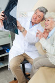 Radiologist Explaining X-ray To Patient — Stock Photo