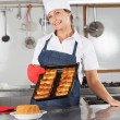 Female Chef Holding Tray Of Baked Breads — Stock Photo