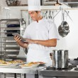 Happy Chef Using Digital Tablet In Kitchen — Foto Stock