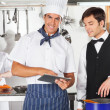 Chef With Waiter Using Digital Tablet — Stock Photo
