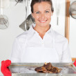 Female Chef With Tray Of Meat — Stock Photo #21124447