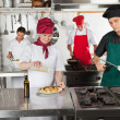 Chefs Working In Restaurant Kitchen — Stock Photo