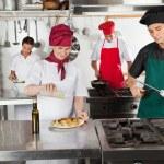 Chefs Working In Restaurant Kitchen — Stock Photo #21124681