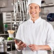Happy Chef Holding Tablet Computer — Stock Photo