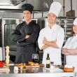 Stock Photo: Chefs Standing With Arms Crossed
