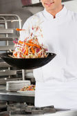 Chef Flipping Vegetables in Wok — Stock Photo