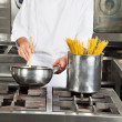 Male Chef Cooking Food In Kitchen — Stock Photo