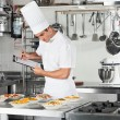 Chef With Clipboard Going Through Cooking Checklist — Stock Photo #21178147