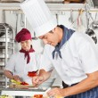 Stock Photo: Male Chef Garnishing Dish