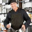 Male Chef Holding Wire Whisk And Mixing Bowl — Stock Photo