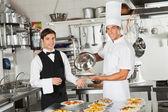 Waiter Taking Customer's Food From Chef — Stock Photo