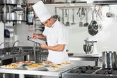 Chef With Clipboard Going Through Cooking Checklist — Stok fotoğraf
