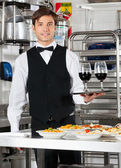 Waiter Holding Wineglasses on Tray — Stock Photo