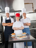 Confident Chefs With Sweet Dishes On Kitchen Counter — Stock Photo