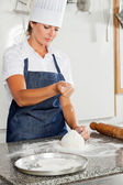 Female Chef Kneading Dough On Counter — Stock Photo