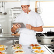 Stock Photo: Happy Chef Using Digital Tablet