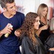 Stock Photo: Hairdressers Setting Up Client's Hair