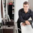 Male Hairstylist With Hairdryer Leaning On Chair — Stock Photo