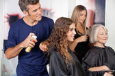 Hairdressers Setting Up Client's Hair — Stockfoto