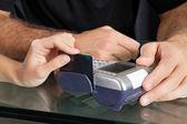 Hand Swiping Credit Card Through Terminal At Salon — Stock Photo