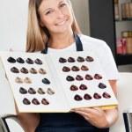 Hairdresser Holding Color Catalog At Salon — Stock Photo #21350381