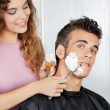 Постер, плакат: Man Getting A Shave From Female Barber