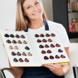 Hairdresser Holding Color Catalog At Salon — Stock Photo #21350381